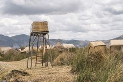 Uros islands landscape. Floating Uros islands landscape at lake Titicaca in Peru royalty free stock image