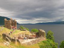 Urquhart Castle. A view of the Urquhart Castle with the Loch Ness on a cloudy day in the background Stock Photo