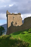 Urquhart castle. Famous scottisch urquhart castle at  loch ness on a hill Royalty Free Stock Photography