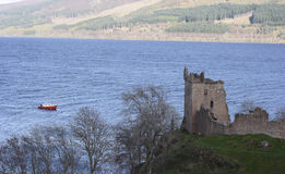 Urquhart Castle with a boat on Loch Ness Royalty Free Stock Photography