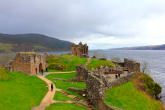 URQUHART CASTLE, LOCH NESS, SCOTLAND, MAY 3, 2016: TOURISTS AMONGST THE RUINS OF THE CASTLE Stock Photography