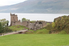 Urquhart Castle on Loch Ness. Urquhart Castle is on the shore of Loch Ness. It was originally build in the 13th Century and is now an ancient ruin.  Loch Ness is Stock Images