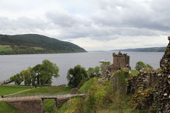 Urquhart Castle on Loch Ness. Urquhart Castle is on the shore of Loch Ness. It was originally build in the 13th Century and is now an ancient ruin.  Loch Ness is Royalty Free Stock Image