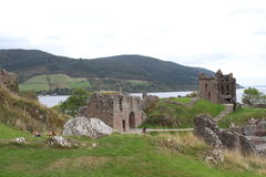 Urquhart Castle on Loch Ness. Urquhart Castle is on the shore of Loch Ness. It was originally build in the 13th Century and is now an ancient ruin.  Loch Ness is Stock Photo
