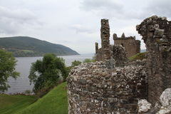 Urquhart Castle on Loch Ness. Urquhart Castle is on the shore of Loch Ness. It was originally build in the 13th Century and is now an ancient ruin.  Loch Ness is Royalty Free Stock Images