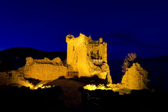 Urquhart castle at night. Scenic view of Urquart castle illuminated on shoreline of Loch Ness, Inverness, Scotland Stock Image