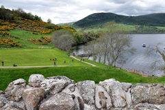 URQUHART CASTLE, SCOTLAND - MAY 30 2013 : Tourist visit Ruin of Historic Urquhart Castle Royalty Free Stock Image