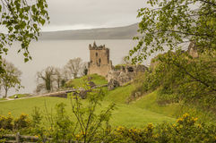 The Urquhart Castle. View of the Urquhart Castle with cloudy skies Royalty Free Stock Photography