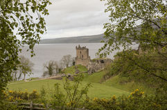The Urquhart Castle. View of the Urquhart Castle on the shores of the Loch Ness on a rainy day Royalty Free Stock Images