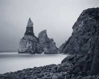 Moonlit Ursa beach. Ursa rock before loosing his head, Ursa beach, Portugal. Moonlit seascape. Long exposure. Analog: 120 film. Toned blue stock photo
