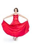 Ursnygg flamencodansare som rymmer hennes röda klänning royaltyfri fotografi