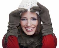 Ursnygg flicka som ler på vit bakgrund Royaltyfria Foton