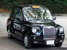 Ursnygg svart London taxitaxi Arkivfoton