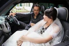 Ursnygga brölloppar i bil Royaltyfria Bilder