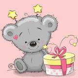 Urso com presente ilustração royalty free