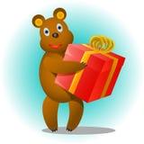 Urso com um presente Fotografia de Stock Royalty Free