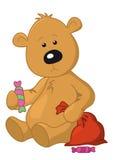 Urso com um saco e um doce Imagens de Stock