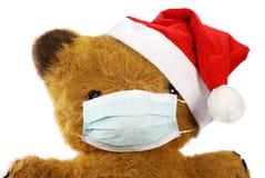 Urso da peluche com máscara da gripe Fotos de Stock Royalty Free
