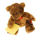 Urso da peluche com notas e lápis Fotografia de Stock
