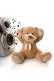 Urso da peluche irritado pela música alta Imagem de Stock Royalty Free