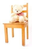 Urso da peluche na cadeira Imagens de Stock