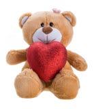 Urso da peluche que prende um coração Fotografia de Stock Royalty Free