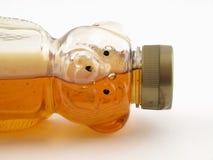 Urso de mel meio cheio derrubado imagem de stock