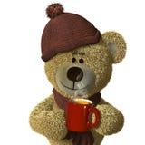 Urso de Nhi com uma caneca cozinhando de chá. Fotos de Stock