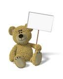 Urso de Nhi que senta-se prendendo um sinal Imagem de Stock