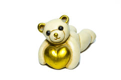 Urso de peluche cerâmico que abraça um coração Fotografia de Stock