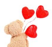 Urso de peluche com balões vermelhos Foto de Stock Royalty Free