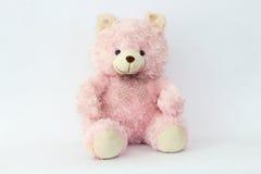 Urso de peluche cor-de-rosa em um fundo branco Foto de Stock