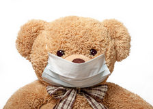 Urso de peluche em uma máscara médica Fotografia de Stock