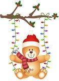 Urso de peluche que balança em luzes de Natal ilustração do vetor