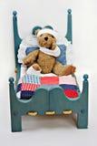 Urso doente na cama Fotografia de Stock