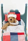Urso doente na cama Fotos de Stock Royalty Free