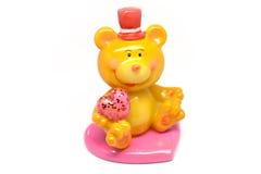 Urso-menino que guarda um coração Fotografia de Stock Royalty Free