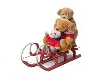 Ursos da peluche em um trenó vermelho Fotos de Stock Royalty Free