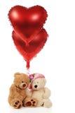Ursos que compartilham de corações Foto de Stock