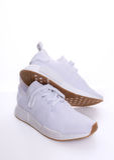 Ursprünglicher NMD R1 Gummi-Satz Adidass alles Weiß Lizenzfreies Stockbild