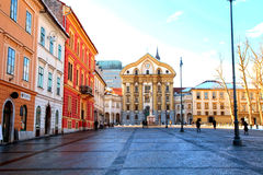 Ursulinska church, Ljubljana, Slovenia. LJUBLJANA, SLOVENIA - FEBRUARY 10, 2015:Town square with Ursulinska church of the Holy Trinity, Ljubljana, Slovenia Royalty Free Stock Images