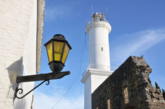 Uruguay. Street lamp and lighthouse in Colonia, Uruguay Royalty Free Stock Photography