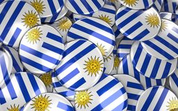 Uruguay Badges Background - Pile of uruguayan Flag Buttons. Royalty Free Stock Photos