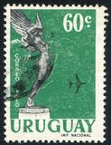 Flight from Monument to Fallen Aviators. URUGUAY - CIRCA 1959: stamp printed by Uruguay, shows Flight from Monument to Fallen Aviators, circa 1959 Royalty Free Stock Photo