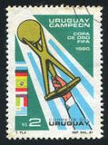 Hand Holding Gold Cup. URUGUAY - CIRCA 1981: stamp printed by Uruguay, shows Hand Holding Gold Cup, circa 1981 royalty free stock image