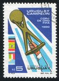 Hand Holding Gold Cup. URUGUAY - CIRCA 1981: stamp printed by Uruguay, shows Hand Holding Gold Cup, circa 1981 royalty free stock photos