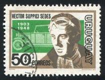 Hector Suppici Sedes and Car. URUGUAY - CIRCA 1974: stamp printed by Uruguay, shows Hector Suppici Sedes and Car, circa 1974 Royalty Free Stock Photo