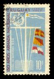 Signal flags and emblem of Uruguay National Navy. Uruguay - circa 1968: A stamp printed in Uruguay shows signal flags and emblem of Uruguay National Navy, issued Stock Photos