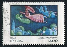 Visiting Angels. URUGUAY - CIRCA 1978: stamp printed by Uruguay, shows Visiting Angels, by Solari, circa 1978 royalty free stock photo
