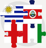 Uruguay, Costa Rica, England and Italy Flags in puzzle Royalty Free Stock Image